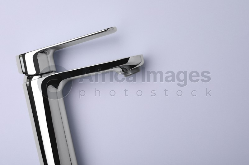 Single handle water tap on grey background, top view. Space for text