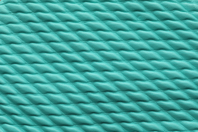 Texture of turquoise leather as background, closeup
