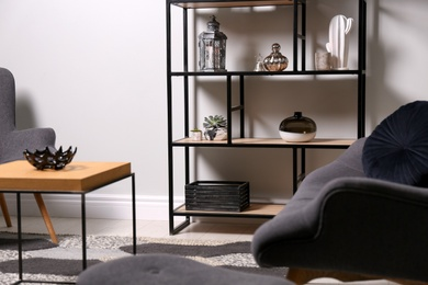 Stylish room with armchairs, coffee table and shelving. Interior design