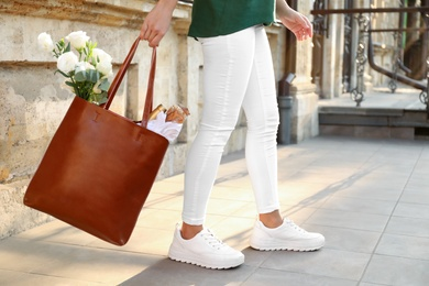 Woman with leather shopper bag outdoors, closeup