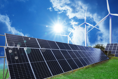 Solar panels and wind turbines installed outdoors. Alternative energy source