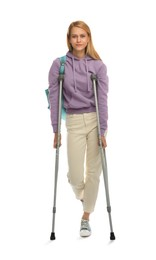 Young woman with axillary crutches on white background