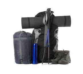 Pair of trekking poles and camping equipment for tourism on white background