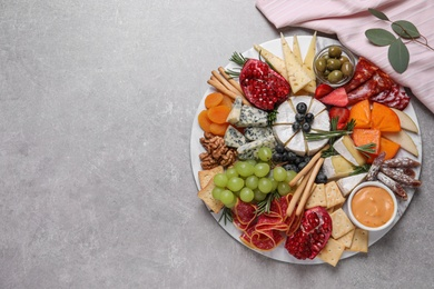 Assorted appetizers served on light grey table, flat lay. Space for text