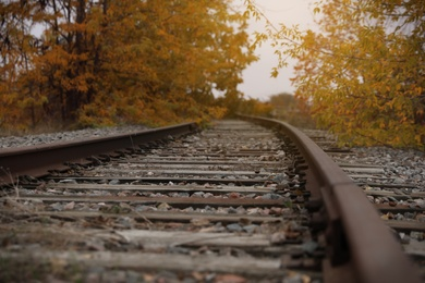 Railway line with track ballast in countryside. Train journey
