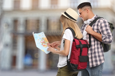 Couple of travelers with map in foreign city. Summer vacation trip