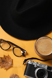 Flat lay composition with stylish hat on yellow background