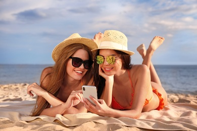 Young couple in bikini spending time together on beach