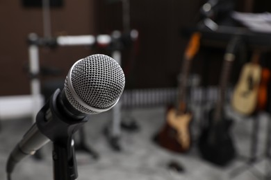 Modern microphone at recording studio, space for text. Music band practice