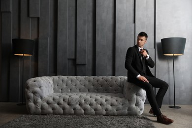 Handsome businessman in stylish living room. Luxury lifestyle