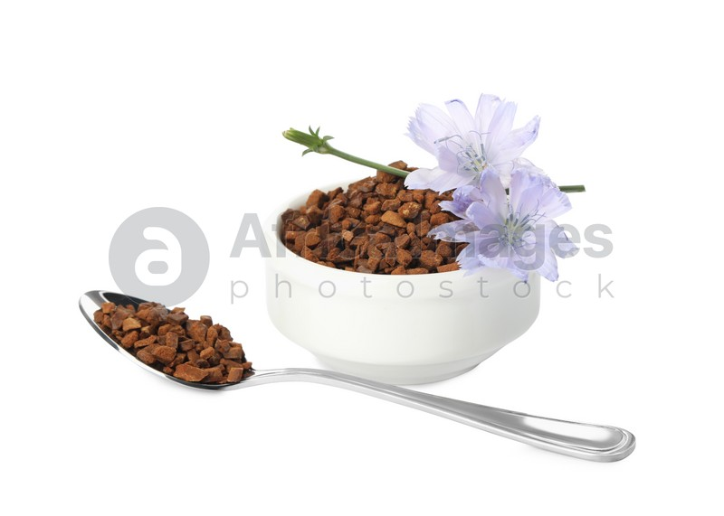 Chicory granules and flowers on white background