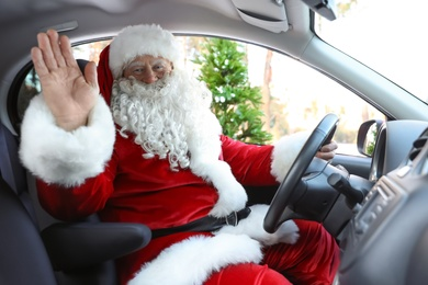 Authentic Santa Claus driving car, view from inside