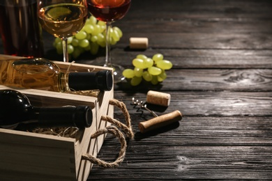 Crates with bottles of wine on wooden table
