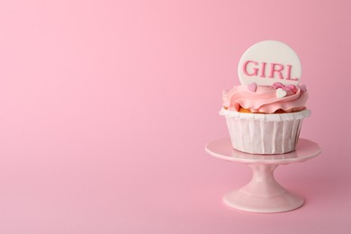 Baby shower cupcake with Girl topper on pink background, space for text