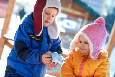 Cute children with toy camera outdoors. Future photographers