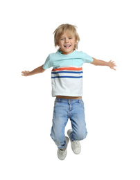 Happy little boy jumping on white background