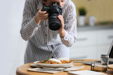Food blogger taking photo of her lunch at table