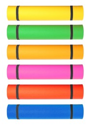Set with different bright rolled camping mats on white background. Vertical banner design