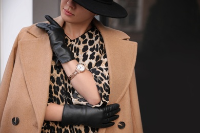 Young woman in stylish black leather gloves outdoors