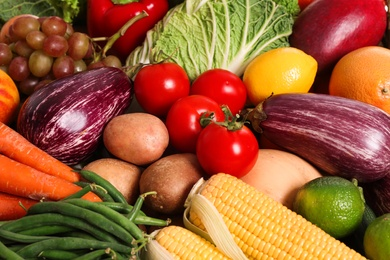Assortment of fresh organic fruits and vegetables as background, above view
