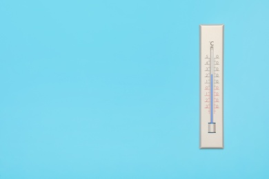 Weather thermometer on light background, top view. Space for text