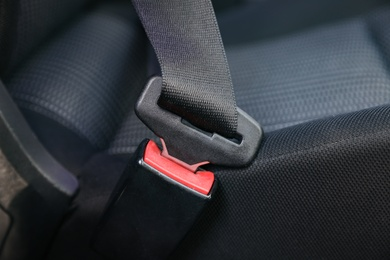 Fastened safety belt on driver's seat in car