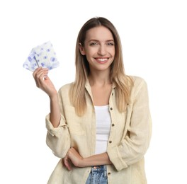 Happy young woman with disposable menstrual pads on white background